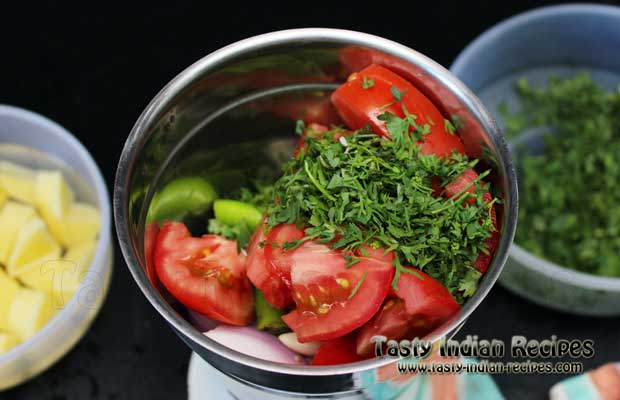 Mix chopped onion, tomatoes, coriander, green chilies, ginger and garlic in a mixer