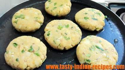 Aloo patties on hot griddle