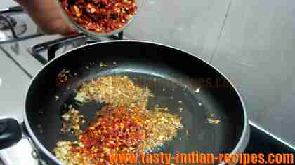 adding-crushed-red-chillies