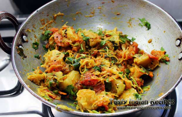 Cook for 2 more minutes and garnish with finely chopped coriander leaves