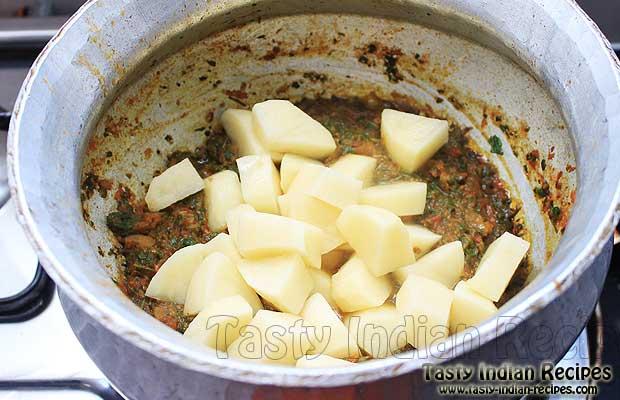 Mixing Potatoes in Methi