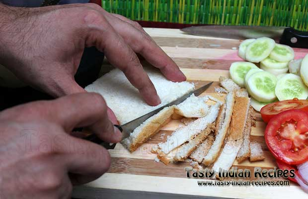 Trim the edges of bread slices with knife