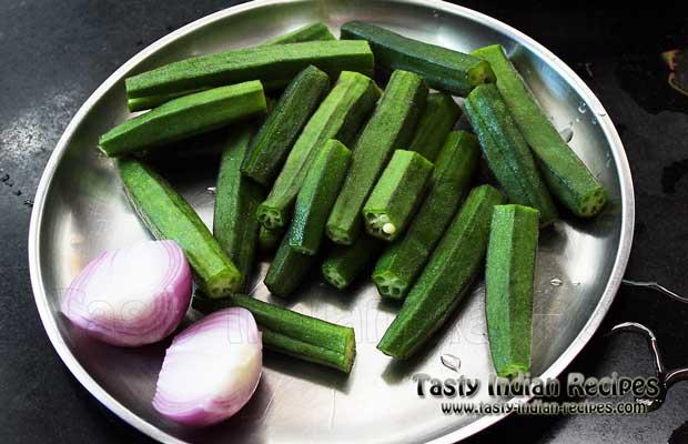 Slit Bhindi vertically and chop the onion in big chunks