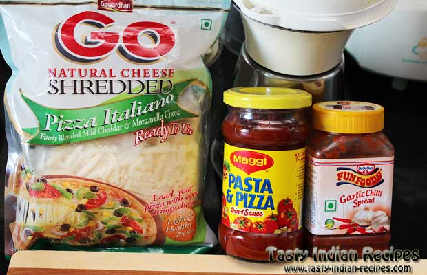 Few Ready Ingredients for making Cheese Pizza