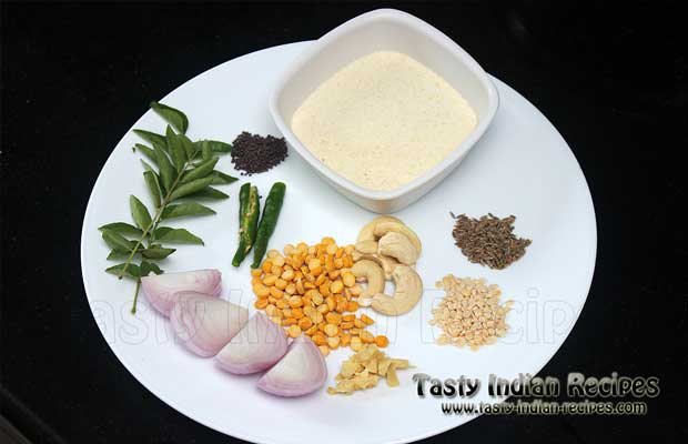 Keep the ingredients ready for making upma recipe (semolina, curry leaves, mustard seeds, cumin seeds, urad dal, chana dal, onion, cashew nuts and green chilies)